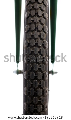 Detail of a bicycle tire isolated on white. - stock photo