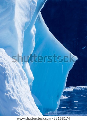 detail of a blue iceberg - stock photo
