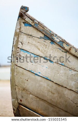Detail of a boat with remains of blue paint - stock photo