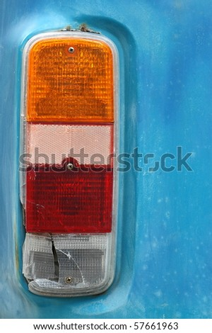 Detail of a Brake Light on a Weathered Vintage Camper Van - stock photo