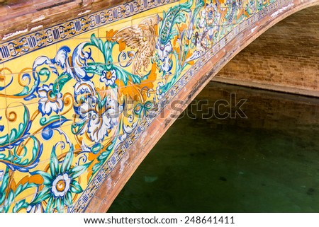 Detail of a bridge decorated with azulejos at Palacio Espanol on Plaza De Espana, Seville. - stock photo