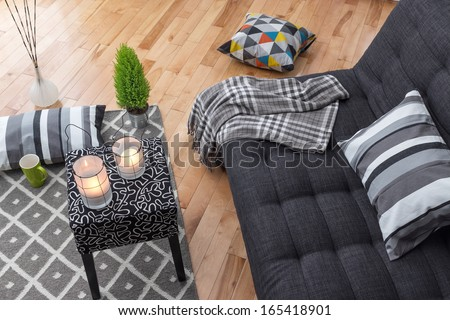 Detail of a bright modern living room with gray sofa. - stock photo