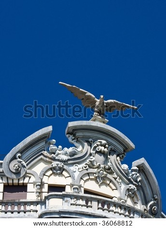 Detail of a building with a stone eagle arrives - stock photo