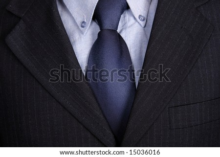 detail of a Business man Suit with blue tie - stock photo