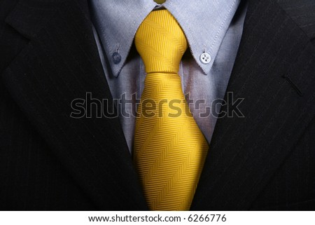 detail of a Business man Suit with yellow tie - stock photo