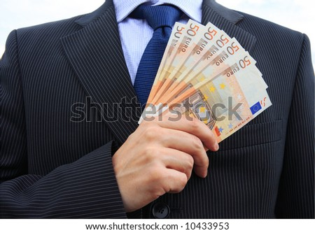 Detail of a businessman hand with lot of money - stock photo