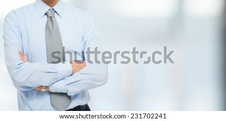 Detail of a businessman with folded arms, large copyspace - stock photo
