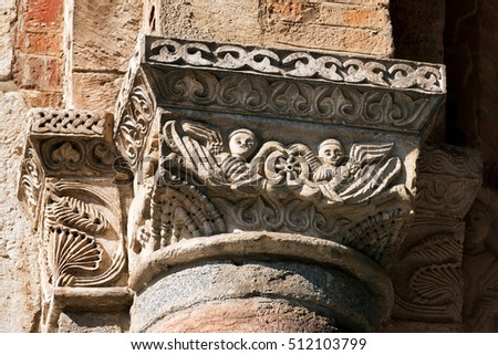 Detail of a capital with column of the famous and ancient basilica of Saint Ambrose (Sant'Ambrogio 379-1099) in Milano, Lombardia, Italy