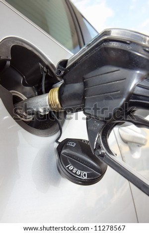 Detail of a car in a filling station - stock photo