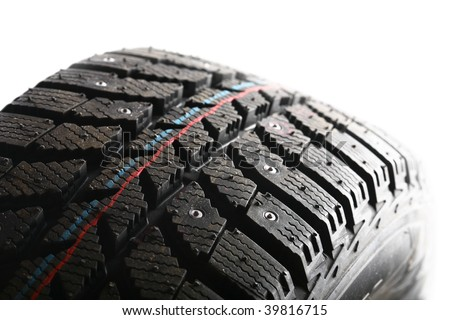 Detail of a car tire isolated on white - stock photo