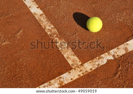 Detail of a clay court with tennis balls - stock photo