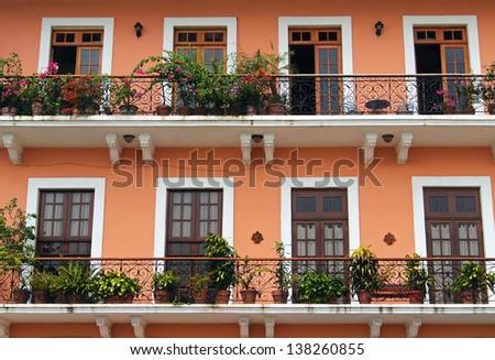 Detail of a colonial house. balcony with flowers and plants, Casco Viejo, Panama City, Panama - stock photo