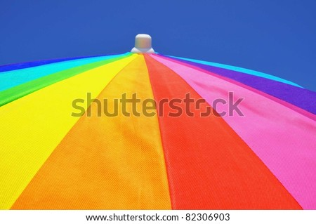 Detail of a colorful beach umbrella, useful as a background texture - stock photo