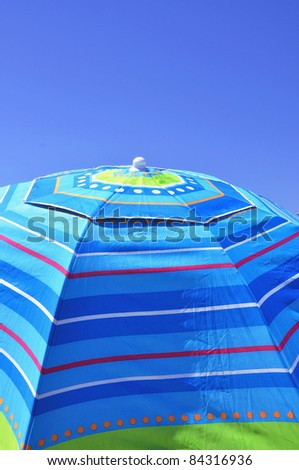Detail of a colorful beach umbrella, useful as a background texture or cover art - stock photo