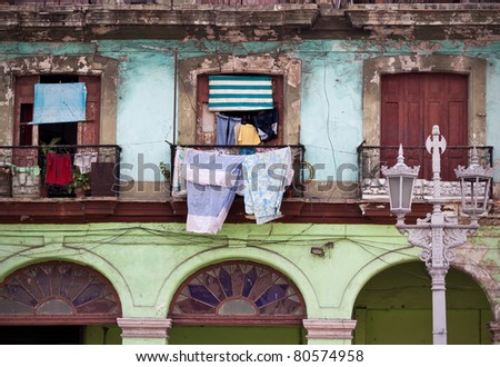 Detail of a colorful dilapidated building in Old Havana - stock photo
