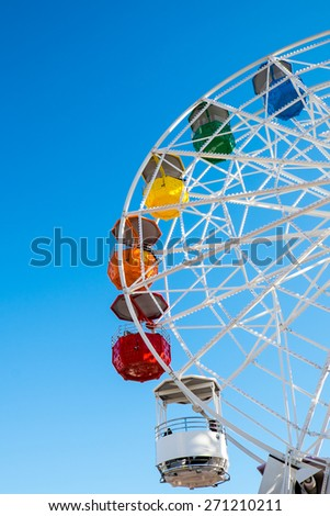 Detail of a colorful ferris wheel seen on a fair - stock photo