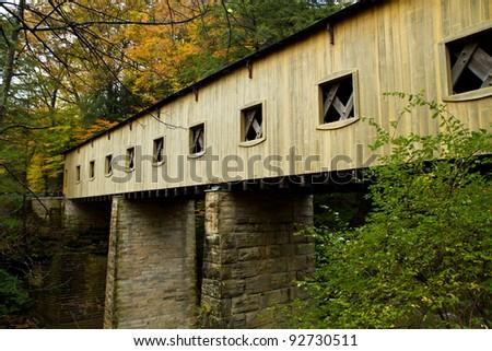 Detail of a covered bridge in Ashtabula County, Ohio on a rainy fall morning - stock photo