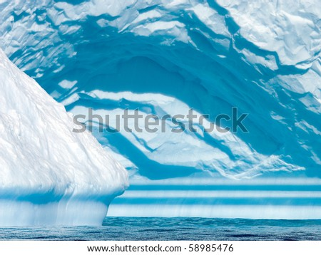 detail of a cyan iceberg in triangular shape - stock photo