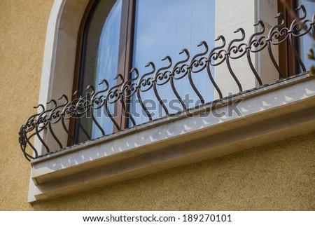 detail of a decorative metal railing window - stock photo