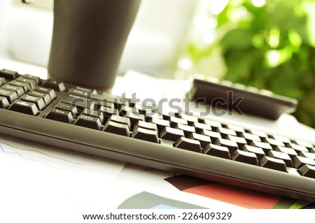 detail of a desk in an office with a nice atmosphere - stock photo