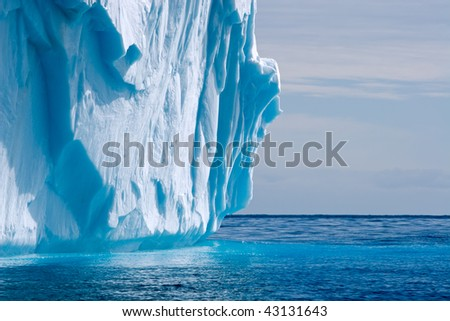 detail of a dripping iceberg - stock photo