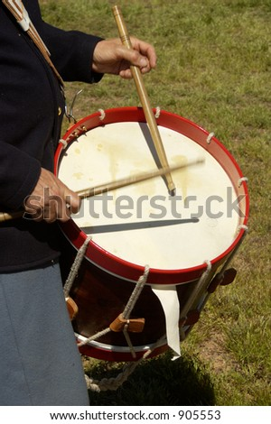 Detail of a drummer in uniform during a civil war battle enactment. - stock photo
