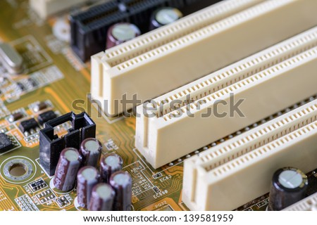 Detail of a dusty computer mainboard