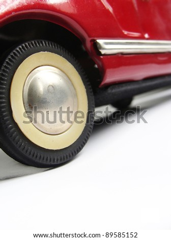 detail of a fifties 50 ' s red tin toy car wheel - stock photo