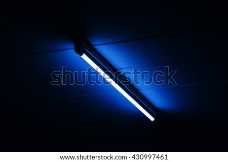 Detail of a fluorescent light tube mounted on a wall with copy space for any design