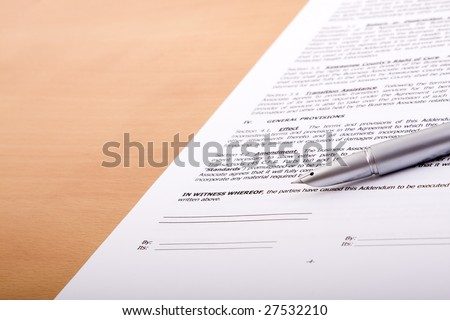 detail of a generic contract with a pen to sign (selective focus) Note: fictitious contract - stock photo