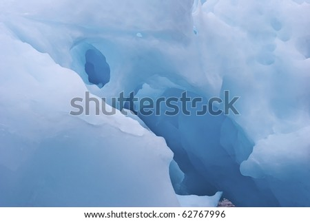 detail of a giant iceberg floating along greenland coasts - stock photo