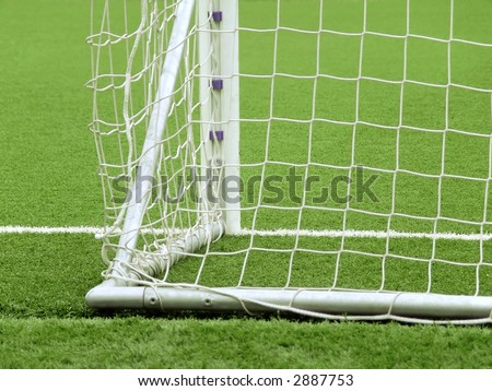 Detail of a goal net and white line in a soccer field - stock photo