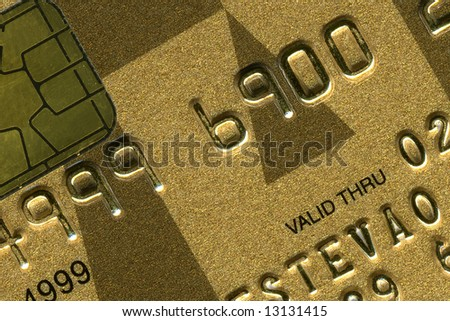 detail of a gold credit card - stock photo