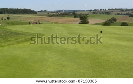 detail of a golf course with trolleys in Southern Germany - stock photo