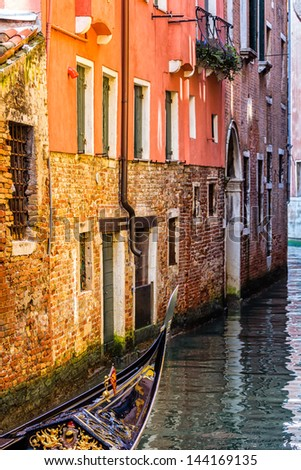Detail of a gondola crossing a canal in Venice - stock photo