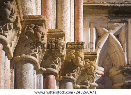 Detail of a Gothic wall with beautiful historical Gothic capitals. Church of Santa Maria de Guadalupe Monastery, Extremadura, Spain. Monks built the cloister in the 14th century.  - stock photo