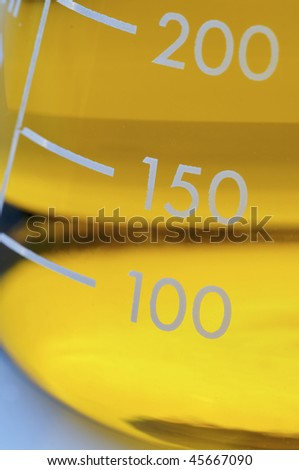 detail of a graduated flask - stock photo
