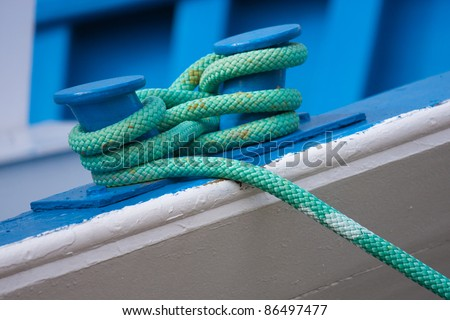 Detail of a green boat rope - stock photo