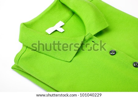 Detail of a green polo shirt on white - stock photo