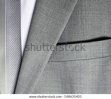 detail of a grey man suit with tie - stock photo
