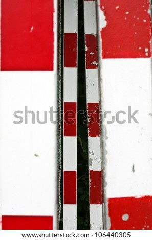detail of a handball goal with red and white stripes