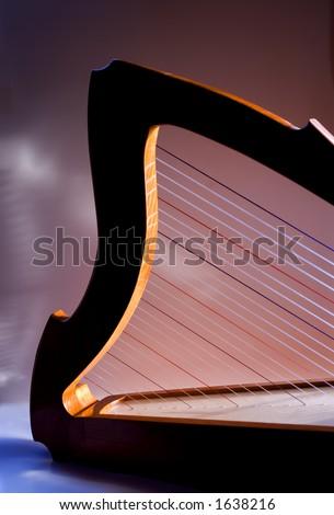 Detail of a handmade shepherd's cherry harp in the light. - stock photo