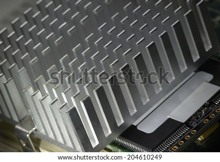 detail of a heat sink on a motherboard - stock photo