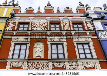 "Detail of a historic building on Market Square in Zamosc, Poland. Zamosc - example of a Renaissance town in Central Europe, designed with Italian theories of ""ideal town"", UNESCO World Heritage List. - stock photo"