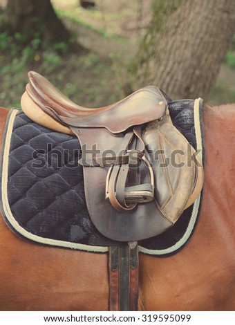 Detail of a horse saddle, horizontal shot. - stock photo
