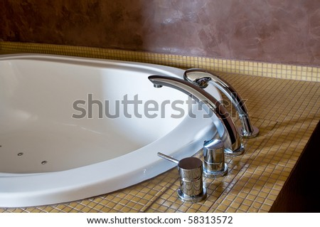 Detail of a Hotel Bathtub with chromed Faucet - stock photo
