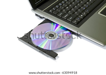 detail of a laptop with open and loaded dvd drive
