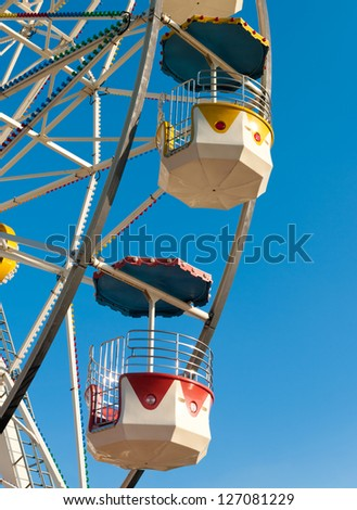 detail of a large ferris wheel against a blue sky - stock photo