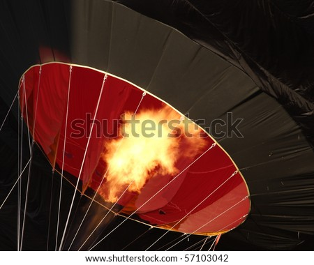 Detail of a large hot air balloon being inflated at dawn for its initial flight. - stock photo