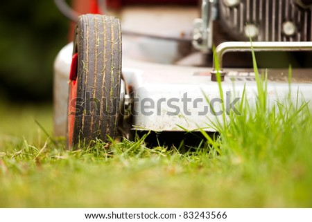 detail of a lawn-mower outdoor - stock photo